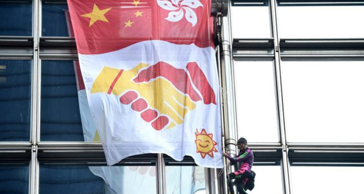French 'Spiderman' scales Hong Kong skyscraper with banner urging peace